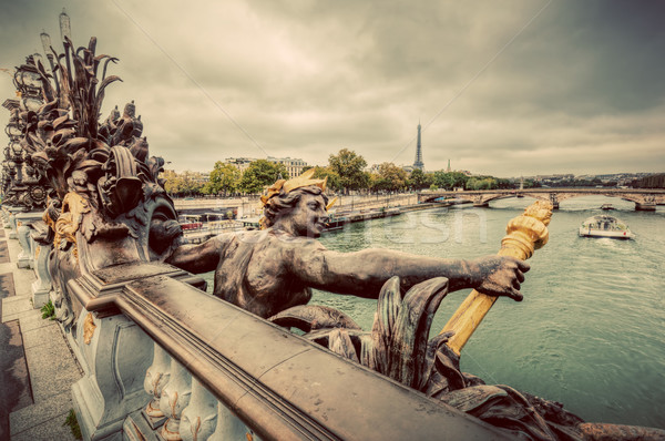 Statue on Pont Alexandre III bridge in Paris, France. Seine river and Eiffel Tower.  Stock photo © photocreo