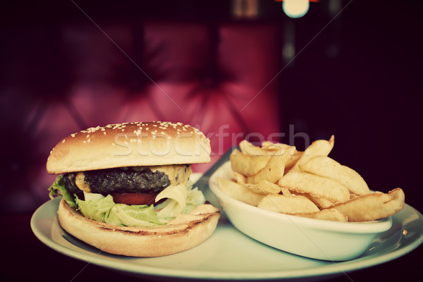 Hamburger and french fries plate in american food restaurant Stock photo © photocreo