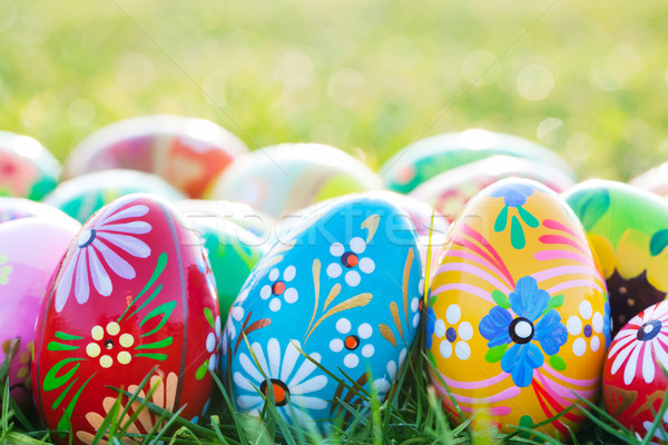 Hand-painted Easter eggs on grass. Spring patterns art, unique. Stock photo © photocreo