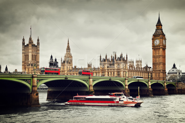 London, the UK. Big Ben, the River Thames, red buses and boat in vintage style Stock photo © photocreo