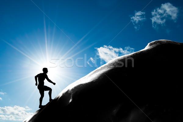 Sziluett férfi fut felfelé domb csúcs Stock fotó © photocreo