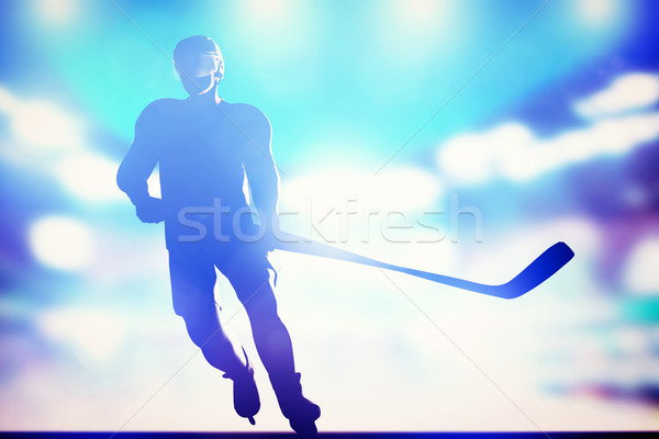 Hockey player skating on ice in arena night lights Stock photo © photocreo