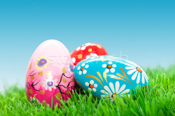 Handmade Easter eggs on grass. Spring patterns, unique. Stock photo © photocreo
