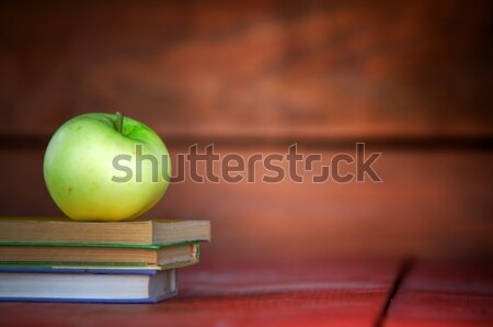 Apple on pile of books Stock photo © photocreo