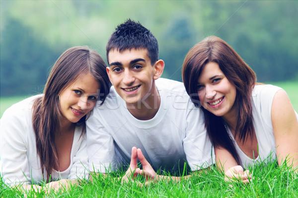 Genç mutlu arkadaşlar üç birlikte gülen Stok fotoğraf © photocreo