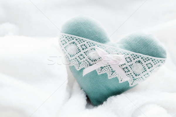 Vintage handmade plush turquoise heart on the soft white blanket Stock photo © photocreo