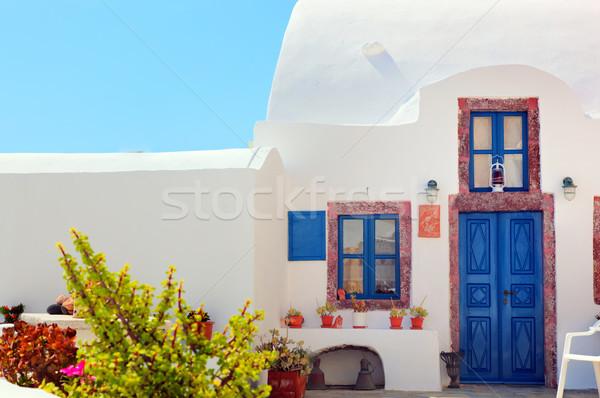 Traditional Greek house with blue door and windows, Santorini, Greece.  Stock photo © photocreo