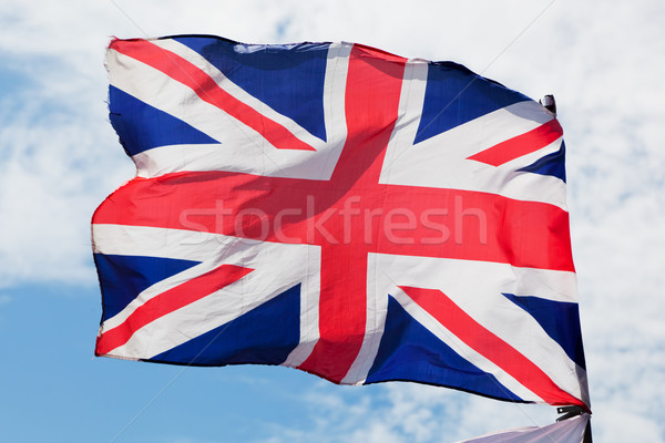 Flaga brytyjska banderą Zjednoczone Królestwo wiatr Błękitne niebo Zdjęcia stock © photocreo