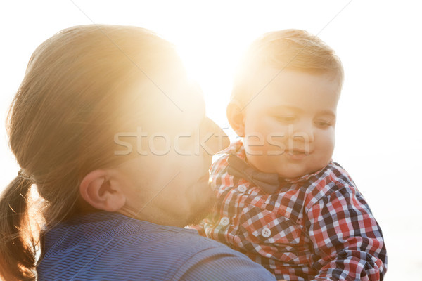 Young father holding his child on the beach portrait Stock photo © photocreo