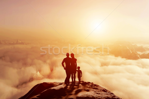 Family together on mountain looking on sunset cloudscape Stock photo © photocreo