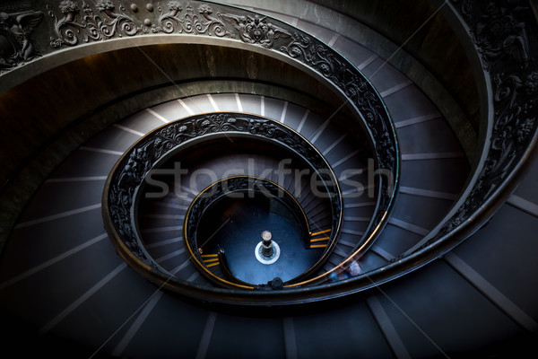 Long spiral, winding stairs. Dark shadows, soft light. Stock photo © photocreo