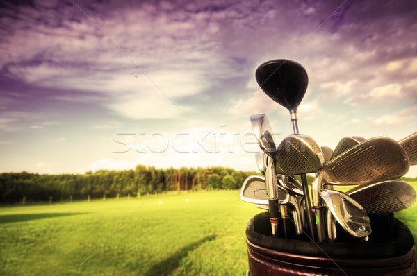 Golf gear, clubs at sunset Stock photo © photocreo