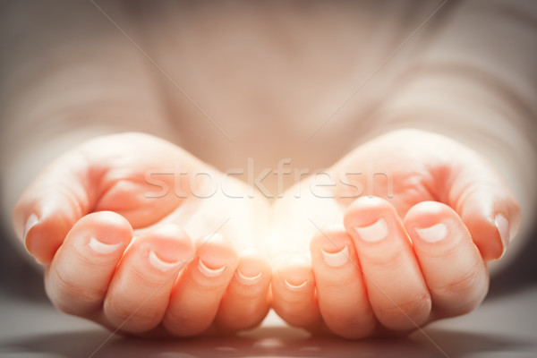 Light in woman's hands. Concepts of sharing, giving, new life Stock photo © photocreo