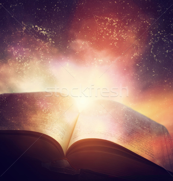 Open old book merged with magic galaxy sky, stars. Literature, h Stock photo © photocreo