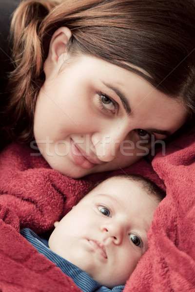 Mother with her young baby cuddling portrait Stock photo © photocreo