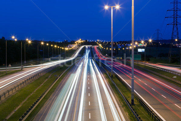 Highway traffic at the evening. Cars lights in motion. Transport, transportation Stock photo © photocreo