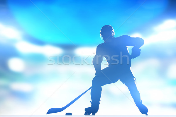 Hockey player skating with a puck in arena lighs Stock photo © photocreo