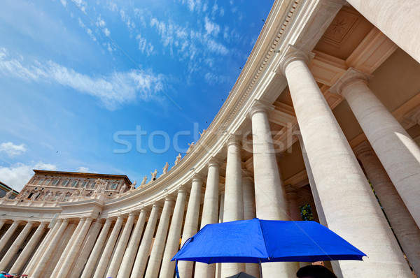 St. Peter's Basilica colonnades in Vatican City. Blue umbrella harmonizes with sky Stock photo © photocreo