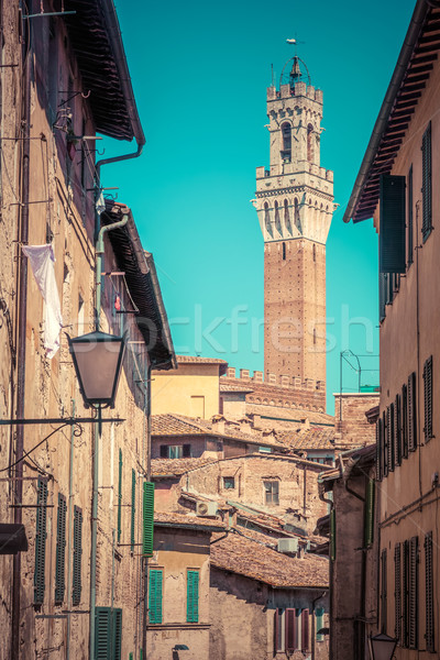 Siena, Italy. Mangia Tower, Italian Torre del Mangia. Tuscany region. Vintage Stock photo © photocreo