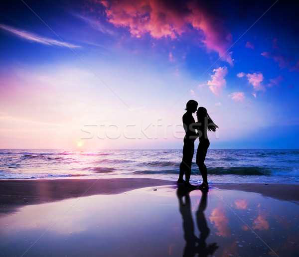Romantic couple on beach at sunset Stock photo © photocreo
