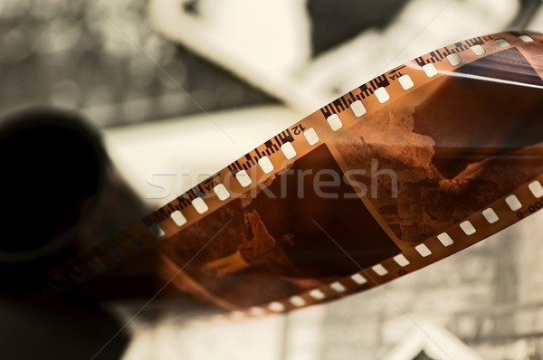 Old film strip and photos background Stock photo © photocreo