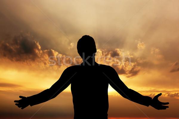 Hombre rezando meditando armonía paz puesta de sol Foto stock © photocreo