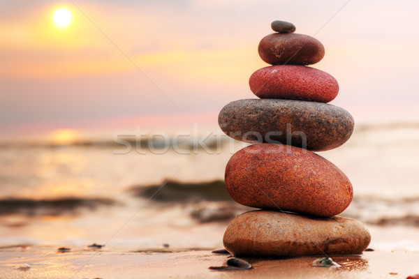 Stock photo: Stones pyramid on sand symbolizing zen, harmony, balance