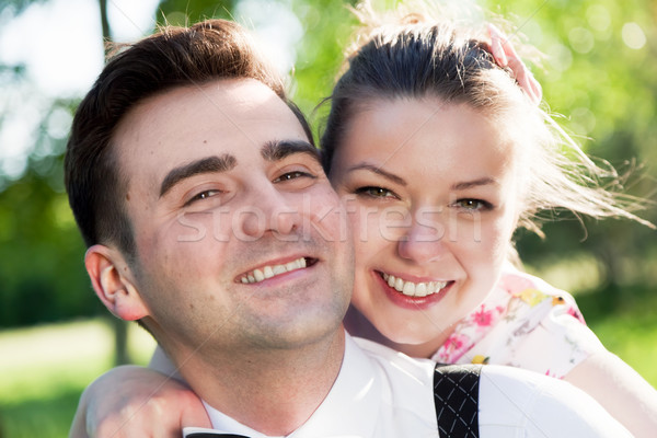 Young smiling couple in love portrait in summer park Stock photo © photocreo