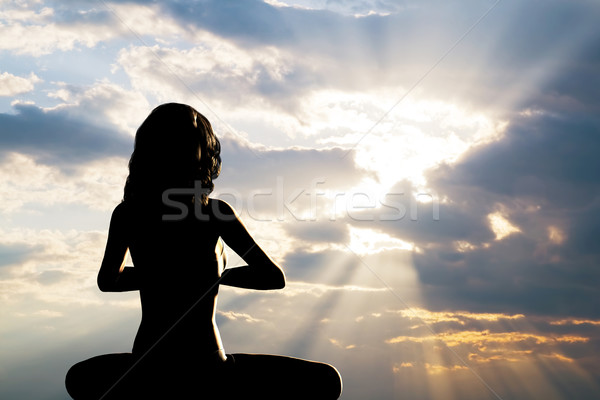 Sziluett nő ül jóga pozició meditál Stock fotó © photocreo