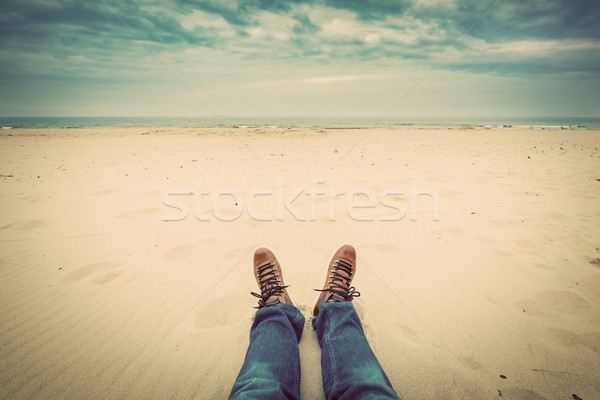 First person perspective of man legs in jeans on the autumn beach Stock photo © photocreo