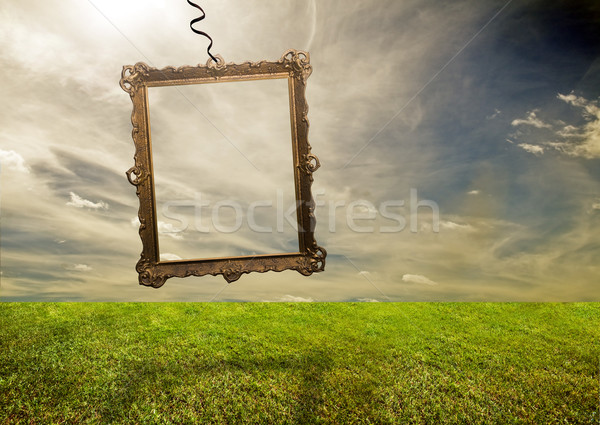 Empty retro frame hanging on poor land Stock photo © photocreo
