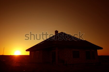 Sunset silhouette of house Stock photo © photocreo