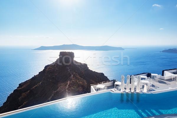 Swimming pool with a view on Caldera over Aegean sea, Santorini, Greece Stock photo © photocreo