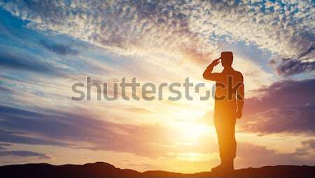 Soldier salute. Silhouette on sunset sky. Army, military. Stock photo © photocreo