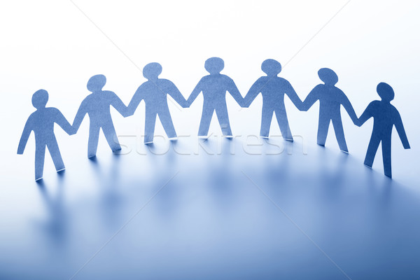 Paper people standing together hand in hand. Team, society, business concept Stock photo © photocreo