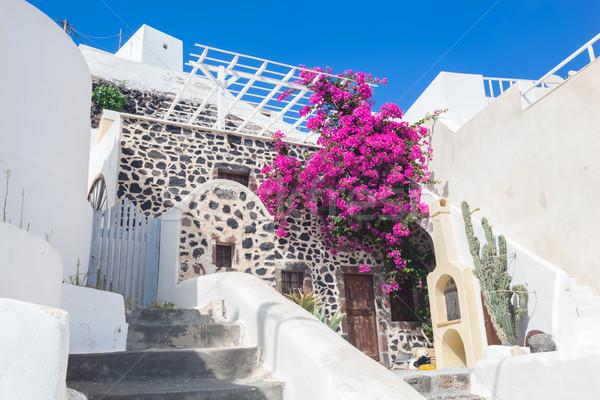 Traditional Greek whitewashed stone house, Santorini island, Greece. Stock photo © photocreo
