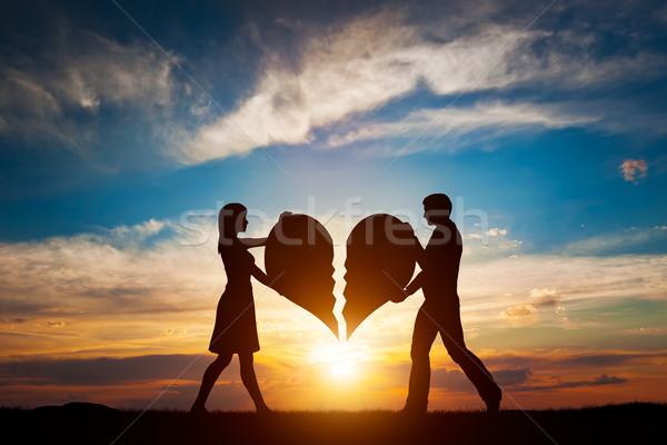Woman and man with two halves of broken heart going to be joined in one. Love  Stock photo © photocreo