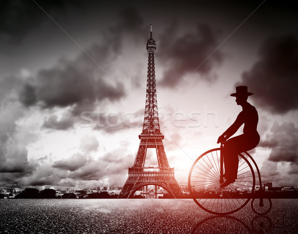 Man on retro bicycle next to Effel Tower, Paris, France. Stock photo © photocreo