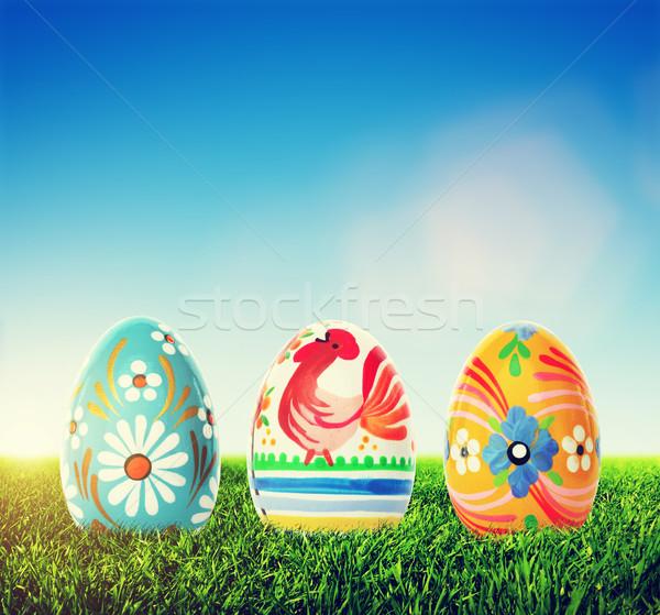 Handmade Easter eggs on grass. Spring patterns art, unique. Stock photo © photocreo