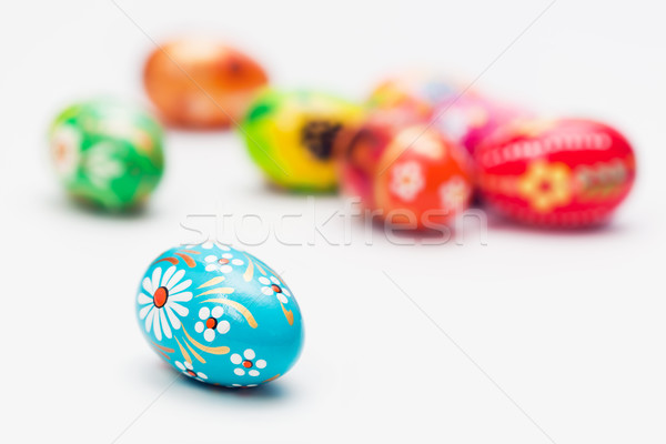 Handmade Easter eggs on white. Spring patterns art, unique. Stock photo © photocreo