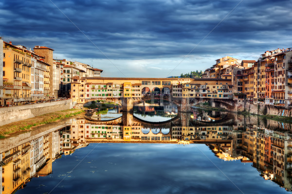 Ponte Vecchio bridge in Florence, Italy. Arno River under dark, stormy clouds. Stock photo © photocreo