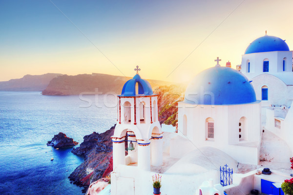 Oia town on Santorini Greece at sunset. Aegean sea Stock photo © photocreo