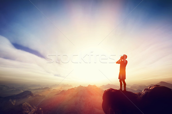 Man screaming on the top of the mounain. Message, calling for help Stock photo © photocreo