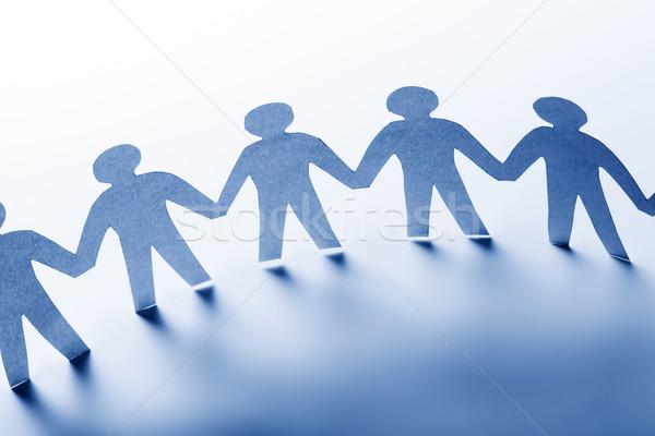 Papieru ludzi stałego wraz strony zespołu Zdjęcia stock © photocreo