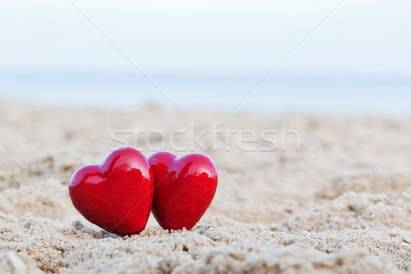 Two red hearts on the beach symbolizing love, Valentine's Day, romantic couple Stock photo © photocreo