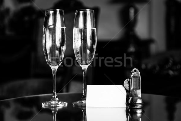 Completo champanhe óculos antigo teclas branco Foto stock © photocreo