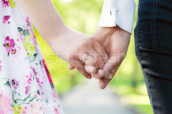 Holding hands close-up. Couple in love dating Stock photo © photocreo