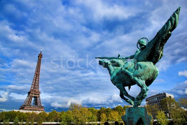 Eiffel Tower, Paris, Fance. Jeanne d'Arc statue Stock photo © photocreo