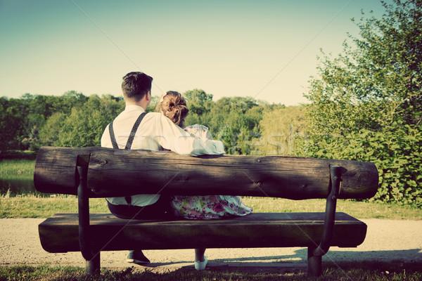 Fiatal pér szeretet ül pad park klasszikus Stock fotó © photocreo