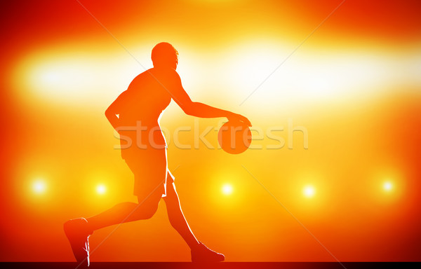 Basketball player silhouette dribbling with ball on red background Stock photo © photocreo